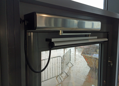 Automatic swing door operator fitted to grey aluminium doors & Automatic swing doors and power assisted doors to EN16005 and DDA ... pezcame.com